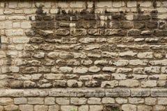 Pared blanca del primer y wheatered vieja de la piedra arenisca imagen de archivo libre de regalías