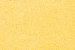 Pared coloreada amarillo brillante, fondo imagen de archivo