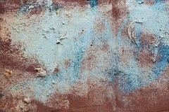 Pared colorida del yeso del viejo vintage con los rasguños, las manchas y las manchas de la pintura imagenes de archivo