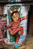 Pared con la pintada en Valparaiso, Chile Foto de archivo