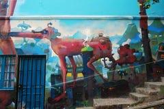 Pared con la pintada en Valparaiso, Chile Imágenes de archivo libres de regalías