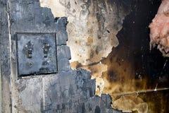 Pared-consecuencias quemadas del fuego de la casa Fotografía de archivo libre de regalías