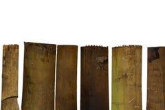Pared de bambú vieja en el fondo blanco imagen de archivo libre de regalías