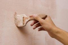 Pared de la pintura de la mano Imágenes de archivo libres de regalías