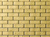 Pared de ladrillo amarilla Imagenes de archivo