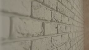 Pared de ladrillo blanca decorativa, primer almacen de metraje de vídeo