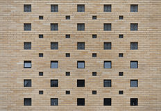 Pared de ladrillo con el fondo de la textura de las ventanas Fotografía de archivo