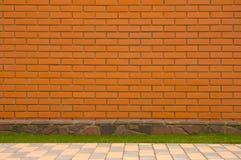 Pared de ladrillo con una frontera de piedra Fotografía de archivo