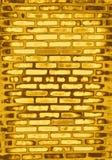 Pared de ladrillo de oro Imagen de archivo