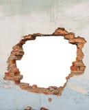 Pared de ladrillo del agujero fotografía de archivo libre de regalías