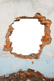 Pared de ladrillo del agujero fotos de archivo