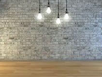 Pared de ladrillo en blanco con el lugar para el texto iluminado por las lámparas arriba Imagenes de archivo