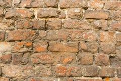 Pared de ladrillo hecha de piedra roja Fotografía de archivo