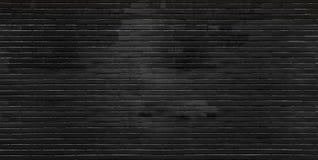 Pared de ladrillo negra fotos de archivo libres de regalías