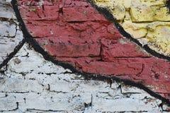 Pared de ladrillo pintada en diversos colores Imagen de archivo
