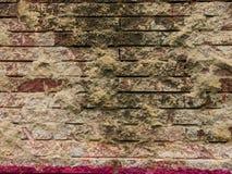 Pared de ladrillo vieja del rojo de ladrillo para un fondo Imágenes de archivo libres de regalías