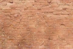 Pared de ladrillo vieja, vieja textura de bloques de piedra rojos Foto de archivo