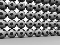 Pared de los balones de fútbol Fotos de archivo libres de regalías