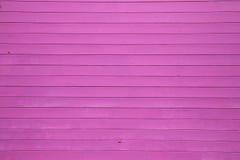 Pared de madera púrpura Fotos de archivo libres de regalías