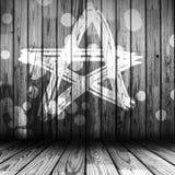 Pared de madera pintada con la estrella Fotos de archivo