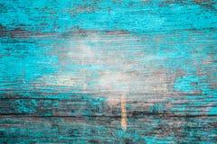 Pared de madera, pintura azul agrietada Foto de archivo