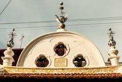 Pared de Penang, Malasia - de Bell de un templo con la escritura árabe Foto de archivo libre de regalías