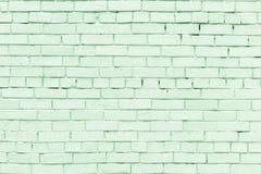 Pared de pequeños ladrillos verdes claros La textura del ladrillo Fondo en blanco Imagenes de archivo