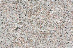 Pared de piedra áspera con los rasguños y el punto horizontales de colores negros, anaranjados y blancos Fotos de archivo libres de regalías