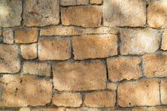 Pared de piedra antigua para un primer del fondo Imágenes de archivo libres de regalías