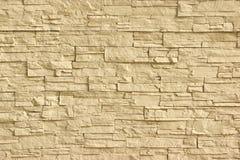 Pared de piedra artificial beige fotografía de archivo libre de regalías