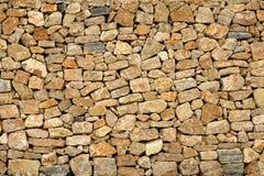 Pared de piedra de la albañilería de oro del edificio viejo Fotos de archivo