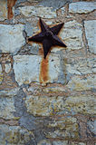 Pared de piedra de la losa con la estrella Imagen de archivo