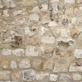 Pared de piedra del granito con la costura del cemento, fondo del marco de la cantería Fotos de archivo libres de regalías