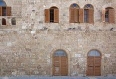 Pared de piedra de la ciudad mediterránea antigua imágenes de archivo libres de regalías