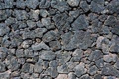 Pared de piedra típica de la roca volcánica, Lanzarote, España Fotografía de archivo libre de regalías
