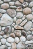 Pared de piedra tallada natural Fotos de archivo libres de regalías