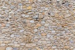 Pared de piedra vieja texturizada áspera del bloque Foto de archivo libre de regalías