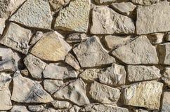 Pared de piedras del diverso tamaño, fondo, serie de la textura Foto de archivo