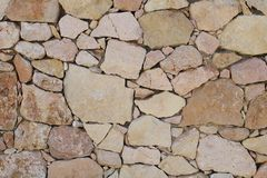 Pared de piedras marrones fotografía de archivo libre de regalías