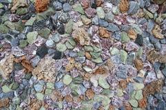 Pared de piedras multicoloras Fotografía de archivo