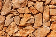 Pared de piedras naturales marrones Imagen de archivo