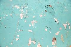 pared del azul o de la turquesa con la superficie de la pintura de la peladura