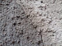 Pared del cemento que se agrieta Imagenes de archivo