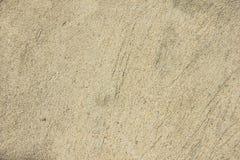 Pared del estuco del amarillo de la textura del fondo de la pared del cemento para el fondo Foto de archivo