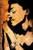 Pared del Grunge con la cara de la mujer africana Imágenes de archivo libres de regalías