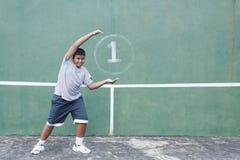 Pared del muchacho y del tenis Imagen de archivo libre de regalías
