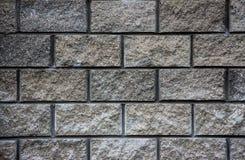 Pared gris de la textura de los ladrillos del granito Fotografía de archivo