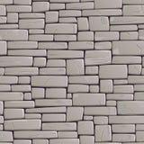 Pared gris inconsútil del fondo de ladrillos agrietados rectangulares Imagen de archivo