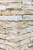 Pared hecha de ladrillos de la piedra arenisca imagen de archivo