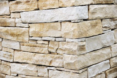 Pared hecha de ladrillos de la piedra arenisca imágenes de archivo libres de regalías